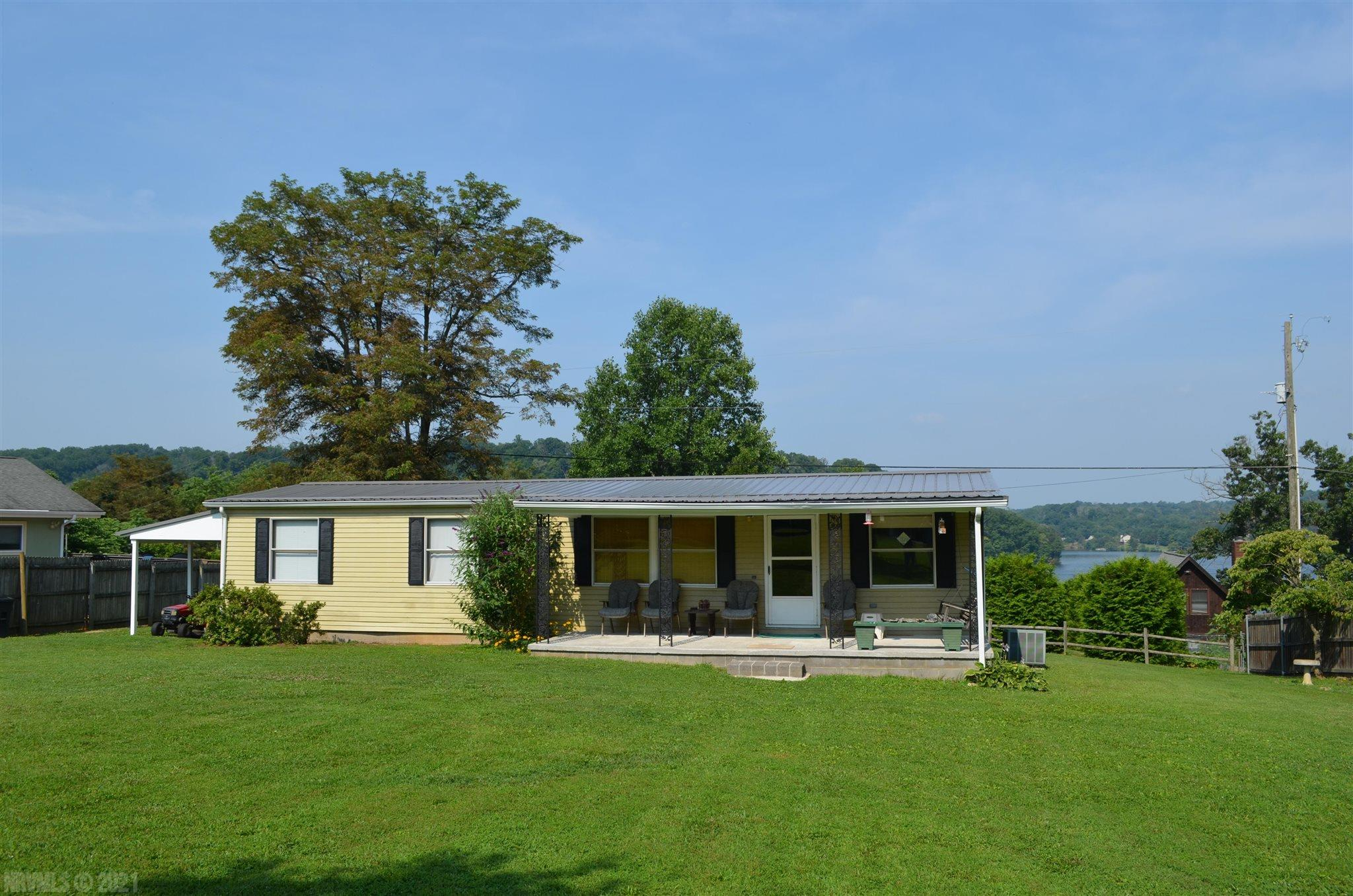 This 3 bedroom Ranch Style modular home sits on a very nice, level, half-acre lot, within walking distance of a shared common area on Claytor Lake. This home also has its own dock suitable for parking two boats.  Come enjoy the beautiful view and personal lake access. Plenty of garden space, nice large deck for entertaining or just to sit and relax.  New Roof and well pump 2020.  Only minutes away Dehaven Park with public boat launch. You can live here year round, use it as a rental, or make it your personal weekend get-away.  Don't miss this opportunity and make
