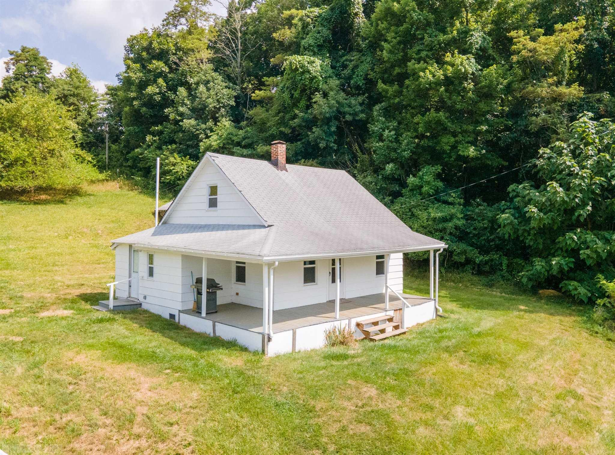 Cozy house in beautiful Floyd County. This 2 bedroom one bath home is perfect with 2.75 acres of open land. A small metal carport and a small out building. Home had updates in 2018 including new electrical panel, flooring, custom trim and paint Great opportunity to own an affordable home in a great location.