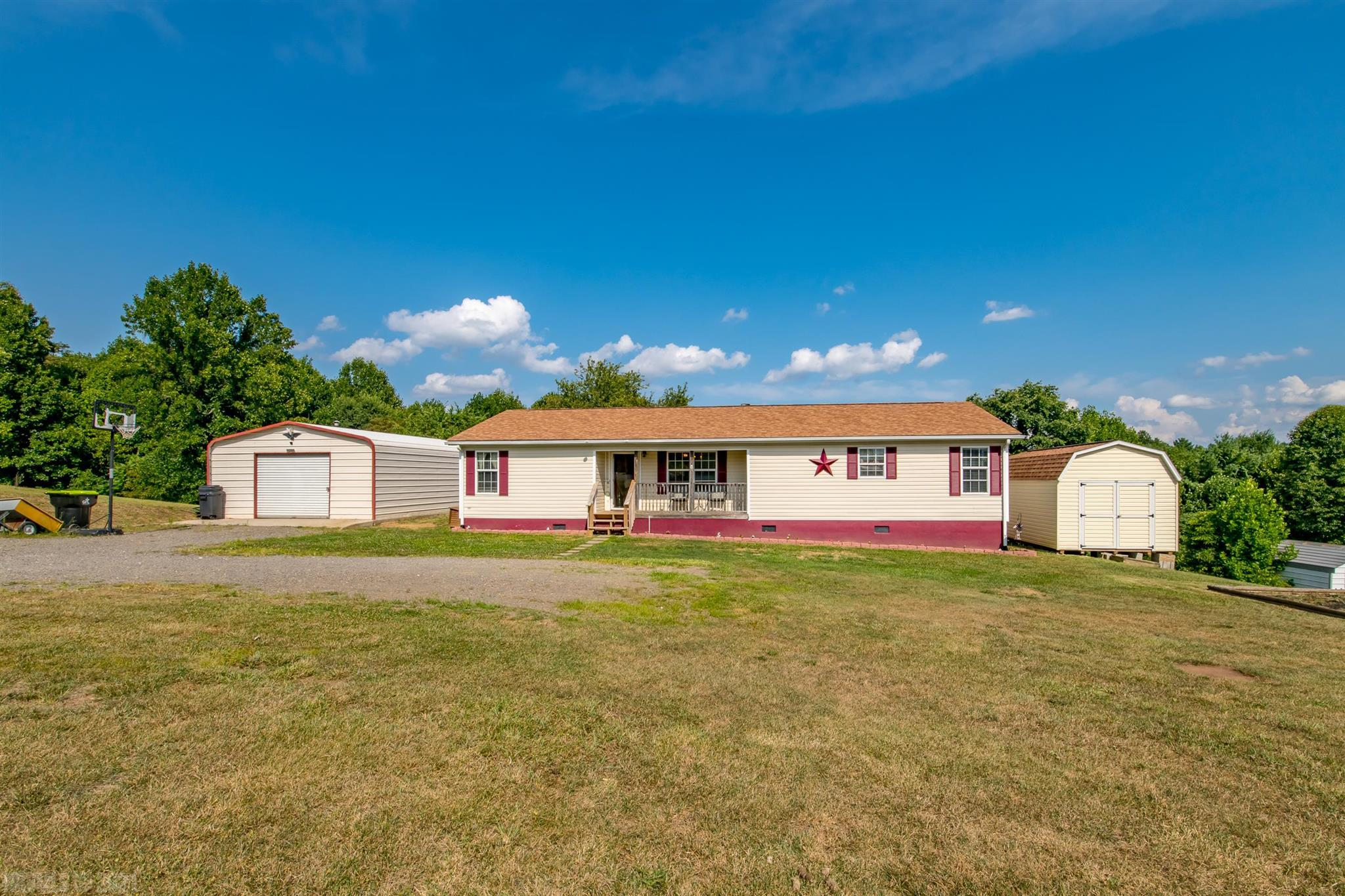 Take a look at this beautifully remodeled 4 bedroom double-wide home in Woodlawn! This home has over an acre of land, and has a small stream in the wooded portion of the property. You have a great layout that utilizes every square inch of this home well. There was a new heat pump installed in 2020 that provides central heat and air for comfort. The covered back deck is perfect for entertaining. You are only about 3 miles from Interstate 77, so your location is very convenient. You're also not right in town. The home has a new roof that was installed in 2018, and comes with a good sized outbuilding, as well as a 20 X 31 2 car garage. The garage has power, as well as a wood stove for heat. There is a lot to offer here, with potential for more. In this market, at this price, this one won't last long. Call today for your chance to see it!