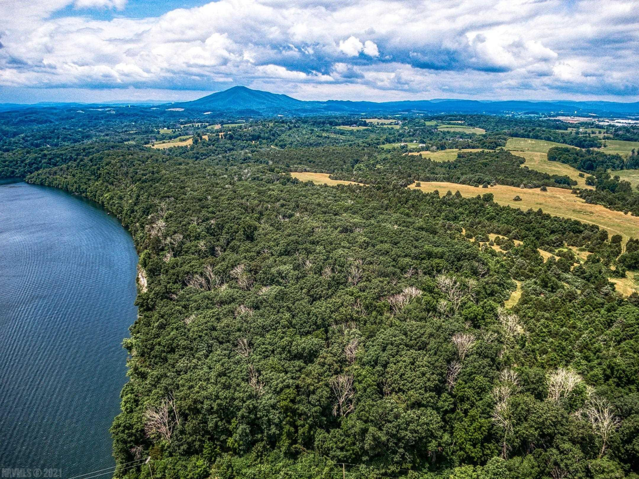 Rare opportunity for property located on  pristine Claytor Lake.  Spectacular long range lake and mountain views. 240+/- acres of land that lends itself to an excellent development opportunity, private estate or compound.  The 3,940' of lake frontage is phenomenal. High bluff with water access, large timber, pond and stream make this property and it's potential limitless. A stunning and unique large tract of rolling, wooded and pastoral land on Claytor Lake is unheard of, so don't miss this opportunity to see it.