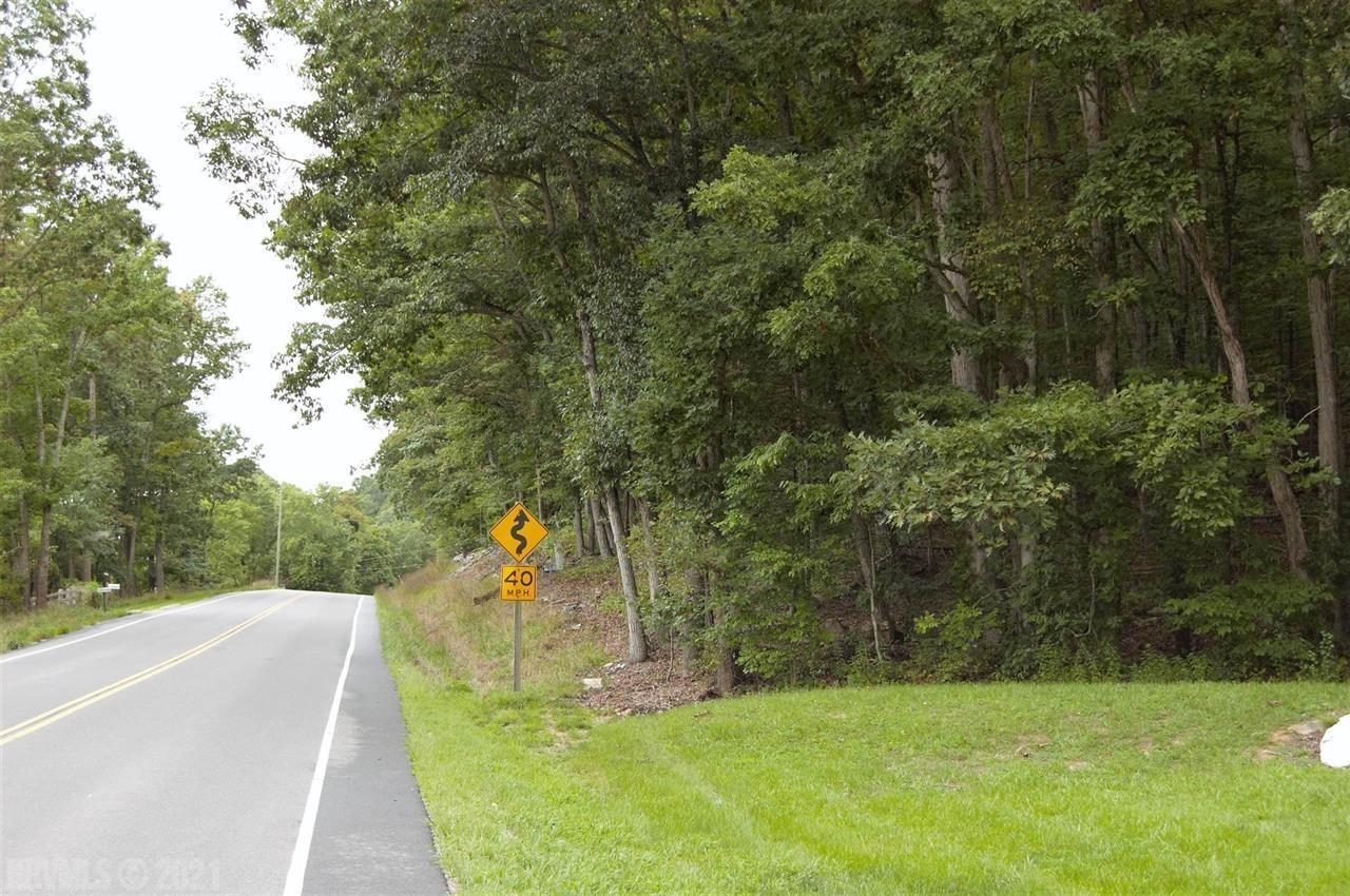 MOTIVATED SELLER OFFERING OWNER FINANCING. 6.4 acres with approx 375 feet of Rte 8 rood frontage.  All wooded with a nice mix of hardwood trees.