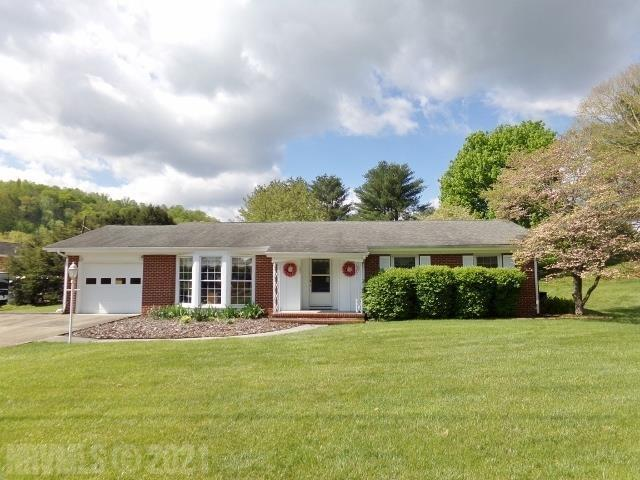 Great location!!  Spacious Brick Ranch on 1.18 acres. Lovely hardwood floors. Updated Kitchen with new stainless dishwasher & oven. Dining RM w/gas logs. Huge back patio. Large Workshop/storage building with concrete floor & electric. Att Garage w/double concrete drive. This home is a must see!!