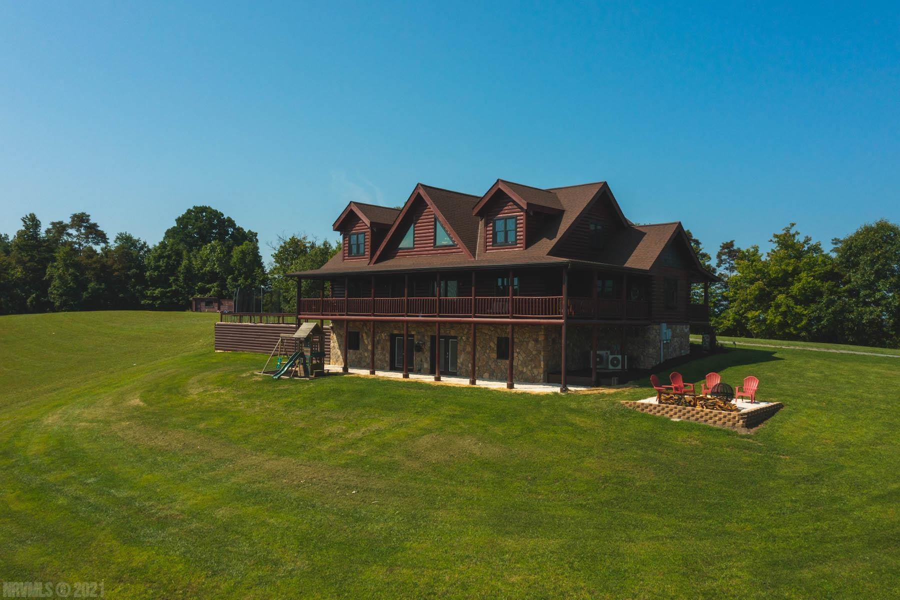 """Absolutely stunning is the words that come to mind with this amazing log home property! Custom built and designed this beautiful log home is an incredible eye catcher perched on the ridgetops of Indian Valley -Floyd VA!  The home offers an abundance of living space, an extraordinary display of custom rock, tile work, blk granite kitchen floor and blk walnut counters.  This property is the complete package both in the home and land. Nearly 80 acres of wooded and open pastures makes this an ultimate recreation property. Deer, turkey & bear are seen almost daily.  Headwaters of what are known as Little Indian Creek form on this property in addition to other springs and streams. Open pastures should you decide to keep livestock, a barn already in place on the eastern boundary of the property.  If all of this was not enough, the VIEWS ARE INCREDIBLE!  Enjoy the 3/4 wrap around Trex covered porch and fire pit area to take in the views of the """"Valley.""""  Call to arrange your private showing!"""