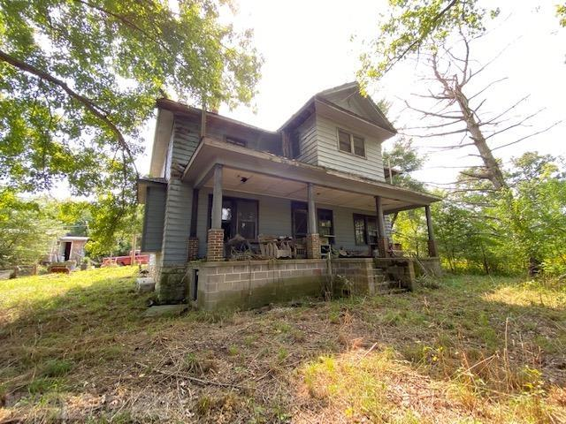 """Looking to Restore a Classic Two-Story Farmhouse on 11.3 Acres?  Look no Further and Bring Your Tools! The Big Home has 2280 Sq. Ft, 4 Bedrooms and 1 Bath! plus there is a 2 Bedroom/1 Bath Cottage that are in need of Capital Improvements or Renovations.  Fireplace is in the large home and unfinished attic in large home has potential.  The Land is Approximately 11.3 Acres of Excellent Pasture or Farm Land with Some Large Oak Timber.  A little stream is on this property too.  Schedule YOUR Tour Today and See This Great Opportunity.  Owners are Very Motivated and Homes and Being Sold """"As Is."""" Shown by Appointment Only.  All information to be deemed accurate, but not guaranteed.  Buyer to confirm details."""