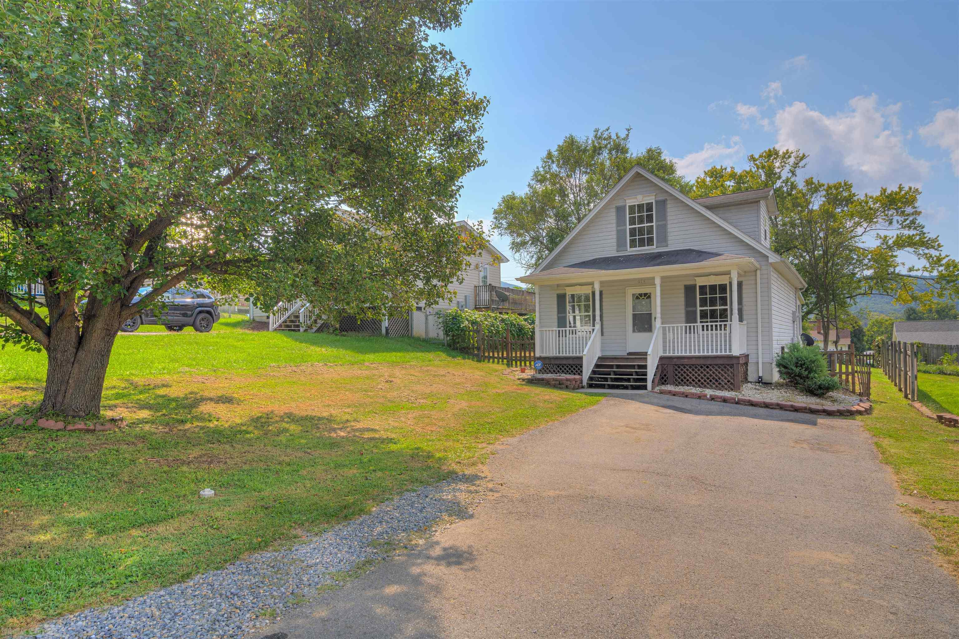 This cute traditional Cape Cod style home sits on a sweet piece of property right in the heart of Pulaski. Large paved drive for extra parking! Mature trees. Enter via the large covered front porch, perfect for summer evenings!  Spacious living/dining room, right off the galley style kitchen with lots of cabinets, windows for natural light, and easy access to the laundry on the main. A full master bedroom with full private bath is right around the corner. Walkout to the sunroom! Upstairs you will find two spacious bedrooms and another full bath. The backyard is fully fenced, and there is a large level patio right off of the sunroom. Garden space along the side of the home, and even a shed. Don't miss that mountain view, clear across the yard, and completely unobstructed. A great way to start or close out your day! Close to area shopping and schools, this won't last long. HVAC new in July 2021. Make your appointment today!