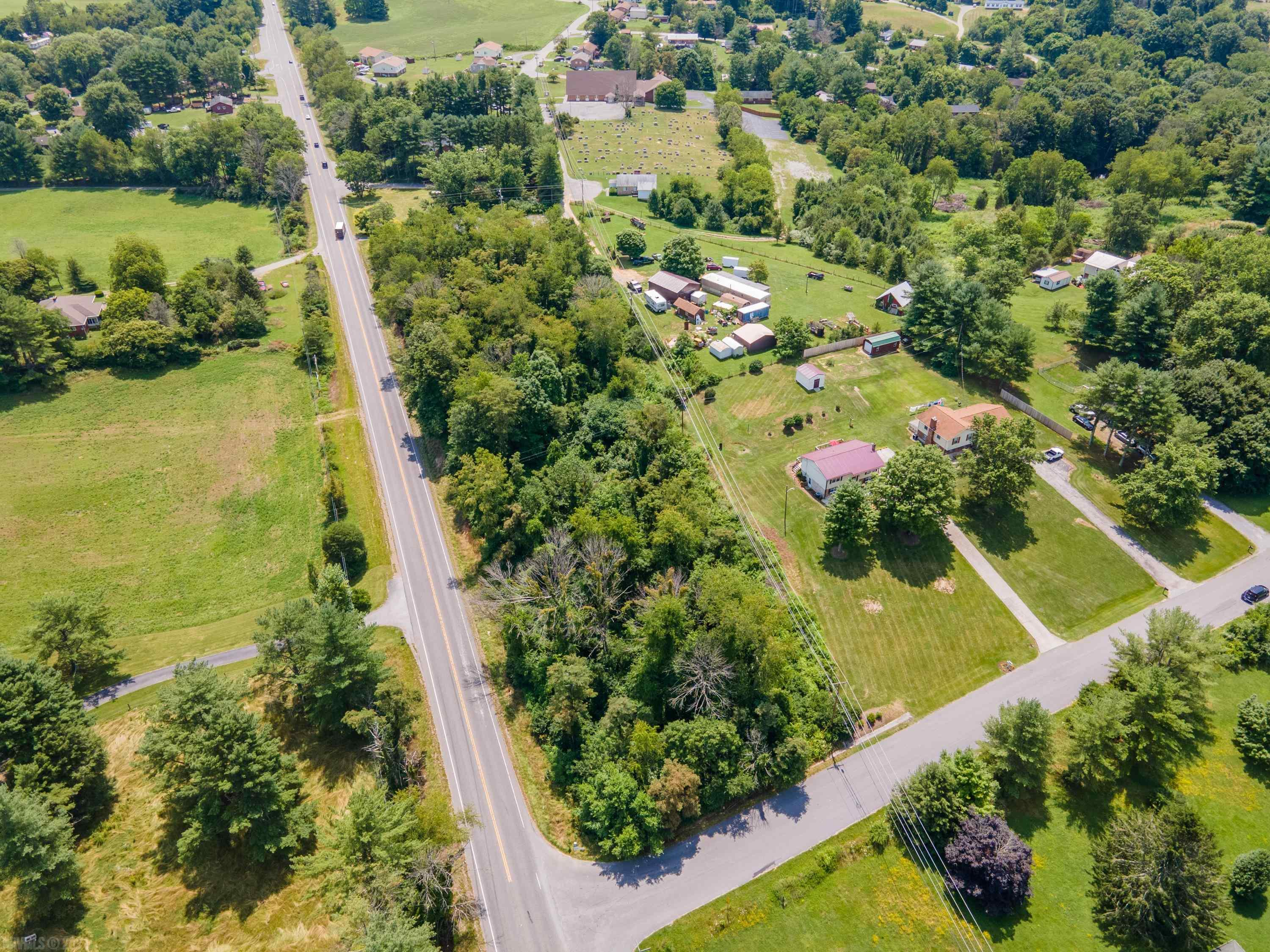 Great opportunity to purchase a 1.783 acre lot on the corner of Peppers Ferry Road and Rolling Hills Drive in Christiansburg. The parcel has 576 ft. of prime road frontage on Peppers Ferry and 122 ft on Rolling Hills and is located just minutes from Virginia Tech and Radford University.  A new survey has been completed and the corners are marked. Excellent location for convenience and visibility.