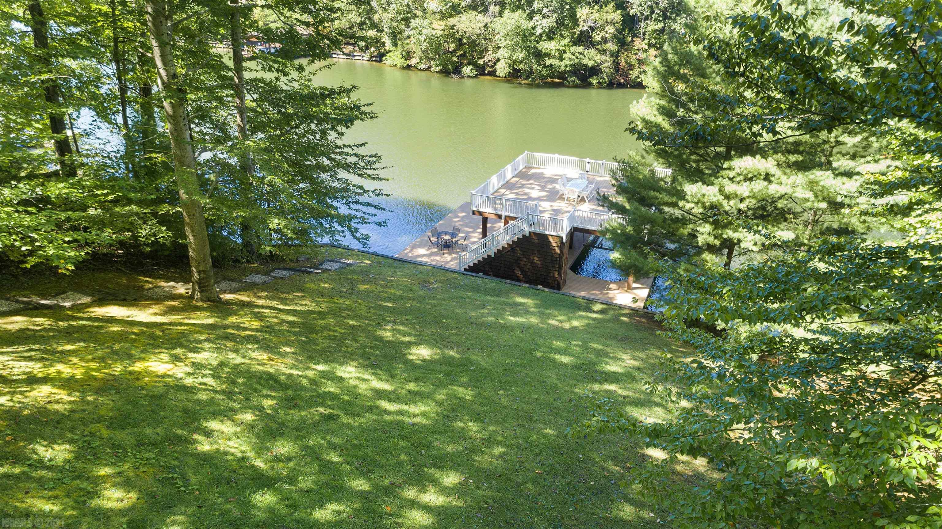 Build your dream home here. Double bay boat lift with all composite decking and railing. Great views from top deck of boat lift. Seawall in place. Easy access to main body of lake. Minutes off I 81, close to shopping & restaurants.