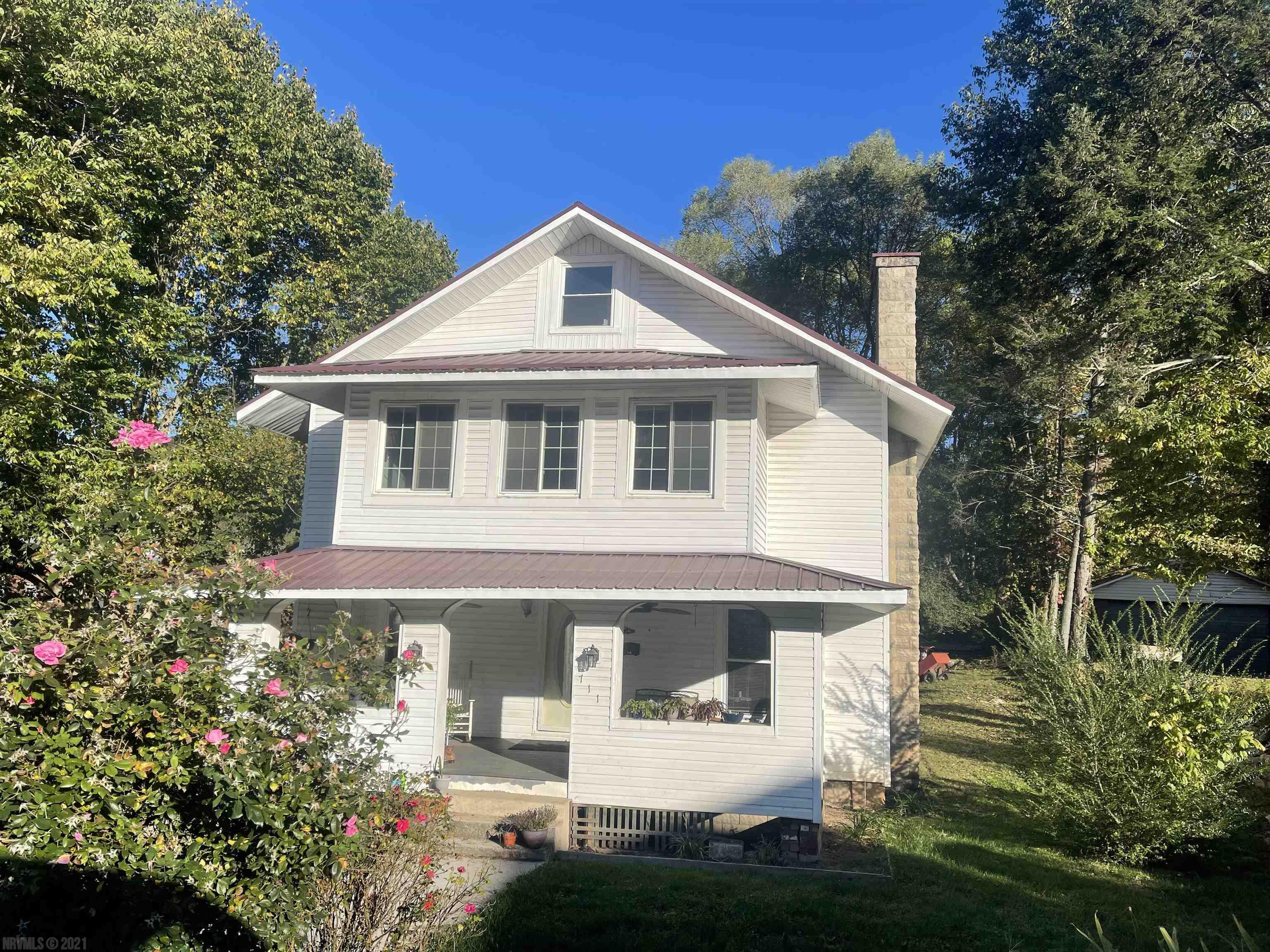 Lovely older home with lots of updates! laundry room with half bath on main, spacious rooms,  Large Master bedroom with full bath & walk in closest. formal dining room, Upstairs has 3 large bedrooms, enclosed sun room, large attic that can be finished, This  home is Family ready! Great Location to Town, School & Park