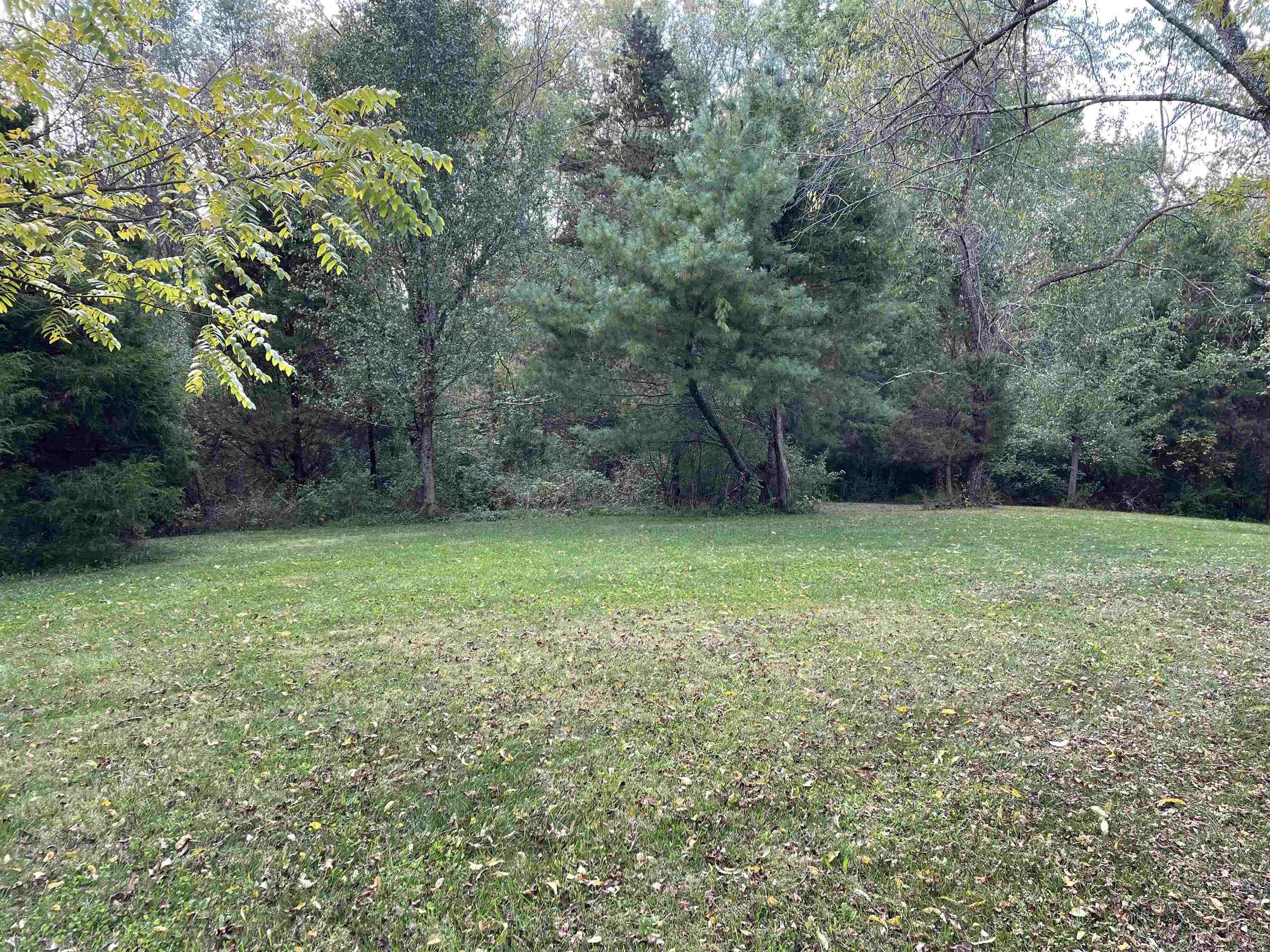 Two desirable lots available in quiet subdivision. Minutes from restaurants, shopping centers, and schools.This multi-use property is located at the end of a cul de sac on partially cleared land. Could be used for residential or multi-family unit. Corners are marked and a fence follows majority of the back property lines. Outside of town limits.