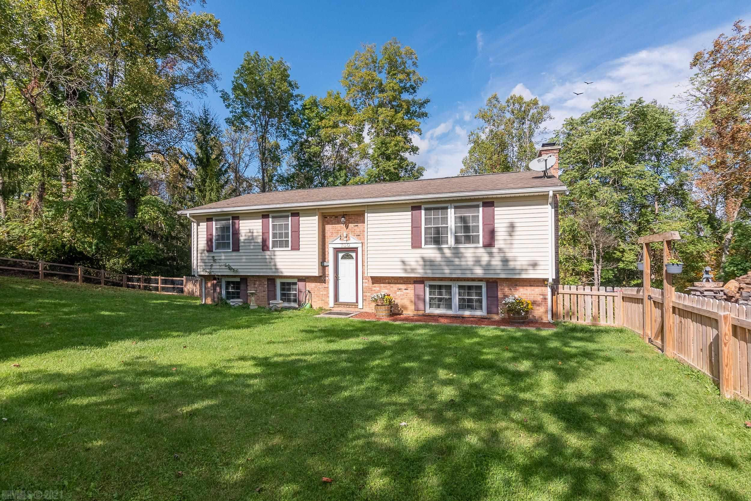 Check out this updated split foyer in the woods. This home has 3 bed and 2 bath, 2200 sq. ft. and sits on 5.4 acres, with a small stream on the back of the property. Beautiful kitchen with stainless appliances, nice deck overlooking the yard. Sit out back and watch the deer & other wildlife in the woods behind you. Also, great land to hunt on if you wish.  Newly fenced front yard to let your dogs run. Cozy den with wood fireplace to relax in the evenings. Private location but close to everything in the NRV. Newer Appliances, water heater and HVAC. Come take a look and fall in love with all this home has to offer.