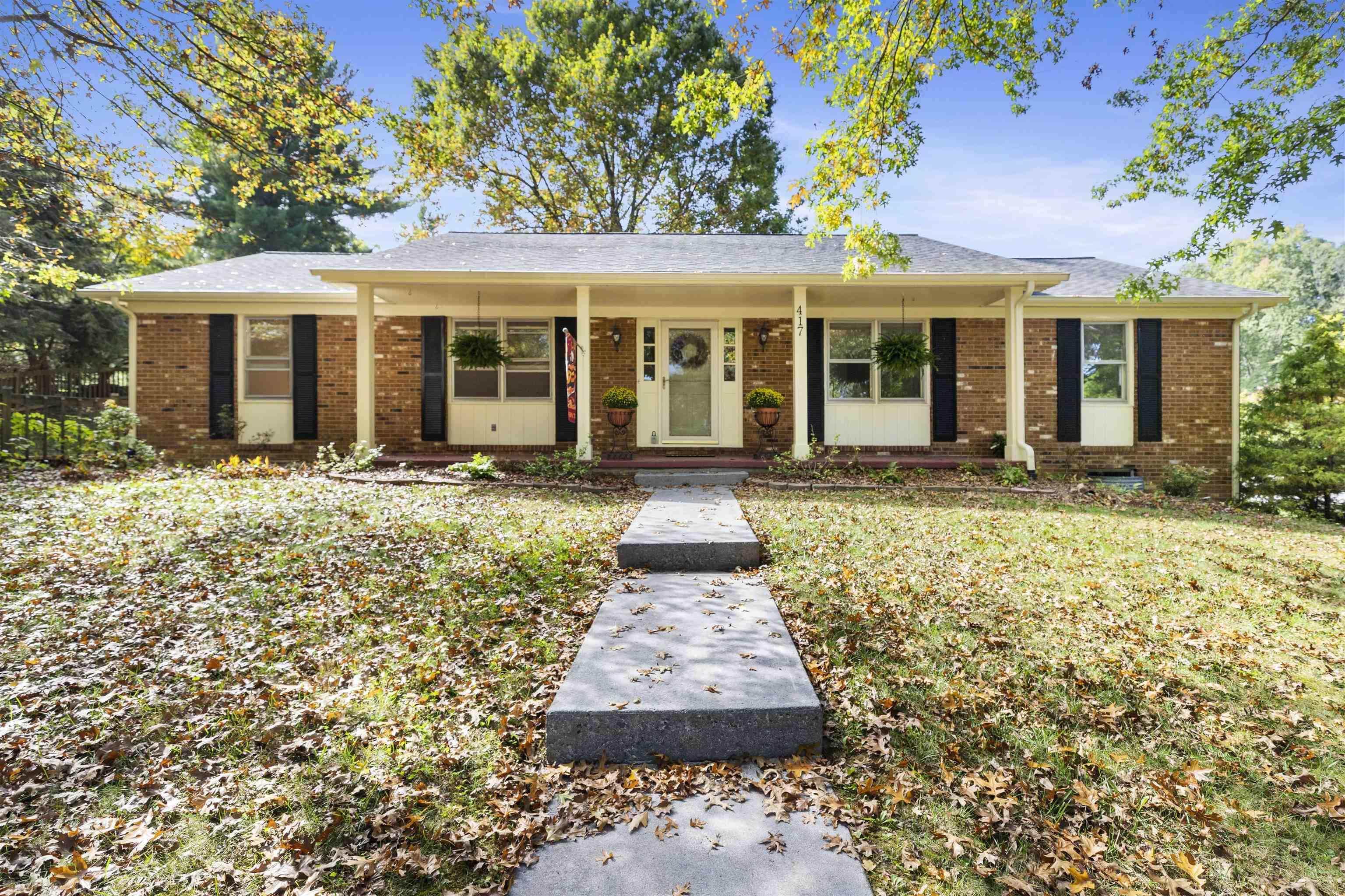 Well-maintained brick ranch home in established, beautiful Blacksburg neighborhood with mature trees. The inviting covered front porch is perfect for porch sitting. This home also has hardscaping that includes paver driveway, walls and walkway which add additional appeal. Inside, the hardwood floors in main floor living areas are newly refinished, plus  freshly painted main level with renovated full baths. The main level family room with brick fireplace opens to the deck, leading to fenced yard with storage shed. Basement has second family room, also with fireplace, and office, half bath, laundry room and storage room.  Oversized double garage includes workshop area with workbench and heater.