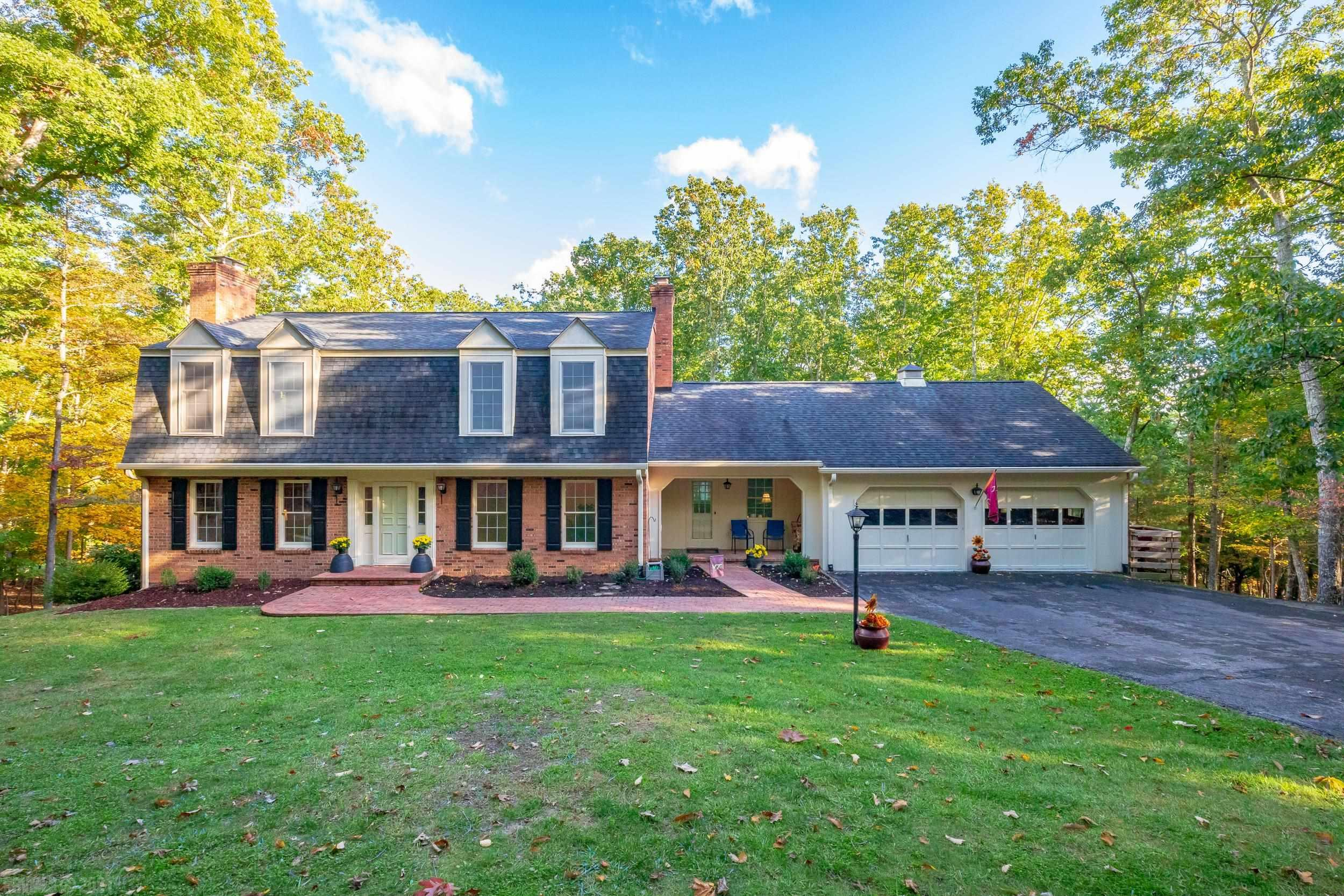 Beautifully updated home in Laurel Ridge just minutes from VA Tech, US-460 and Downtown Blacksburg. Nestled back in the mountains you have over 3 acres of land with an abundance of mature trees offering plenty of privacy. The current owners have updated a majority of the home including all the bathrooms, kitchen, appliances, laundry room, living room, flooring, water heater and had the septic pumped this year. According to the past owners the 2 zone HVAC system was replaced in 2016 and the roof was replaced 2008-2009. There are three fireplaces; wood stove in family room, fireplace in living room and basement. There is a bedroom and full bathroom on the main level with the rest of the bedrooms/bathrooms upstairs. Laundry room is on the main level with large utility sink, extra refrigerator and cabinet space. Large back deck allows you to enjoy mother nature and can be accessed from the dutch door in the kitchen or from the exterior stairs. Full basement with workshop and back patio.